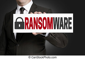 ransomware protection is held by businessman.