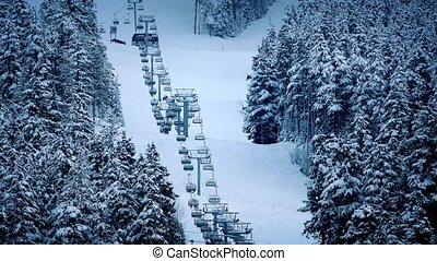 Chairlift Going Up Mountain - Ski-lift going up mountainside...