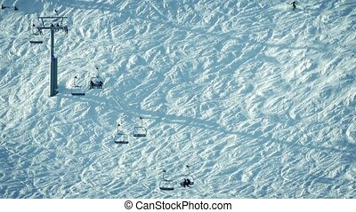 Chairlift And Skiers Wide Shot - Chairlift taking skiers up...