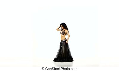 Beautiful young exotic belly dancer with long dark hair in...