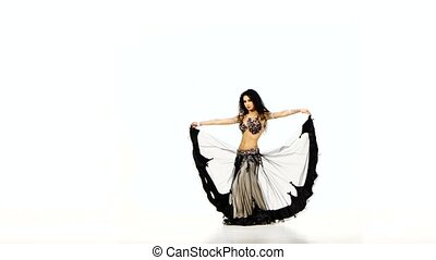 Beautiful young exotic belly dancer shaking her hips, on...