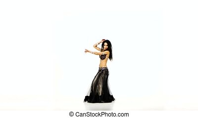Beautiful young exotic belly dancer in unusual suit shaking...