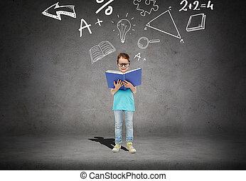 little girl in eyeglasses reading math textbook