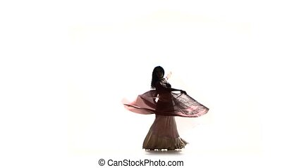 Beautiful exotic belly dancer with two wings and shaking her hips, on white, silhouette, shadow