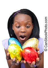 Joyful woman holding colorful Easter eggs isolated on a...
