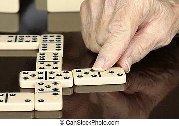 Senior Man Playing Dominoes