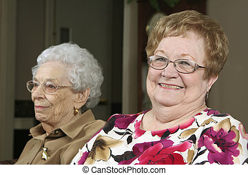 Two Active Seniors - Two active senior women at an assisted...