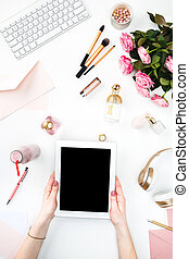 The female hands and tablet against fashion woman objects on...