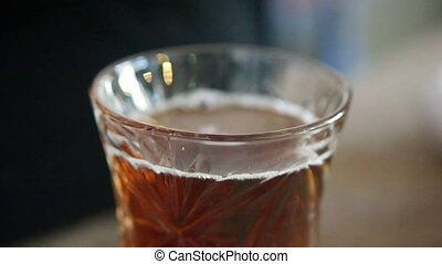 Macro of turkish transparent teacup with hot black tea mix...