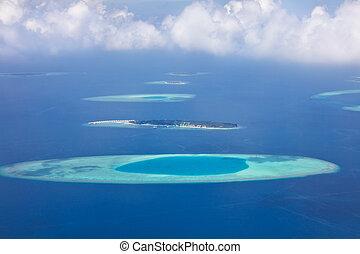 Aerial view on Maldives islands, Raa atol