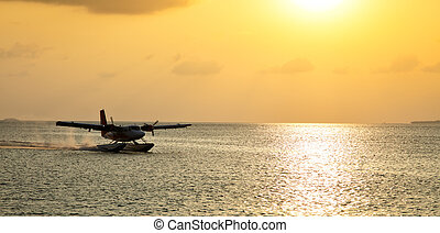 Maldives sea plane in Indian ocean - Landing Maldives sea...