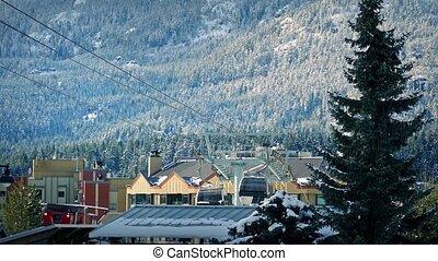 Ski Lift Passing Near Mountain Town