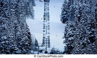 Ski lift Going Up Snowy Mountain - Skilift through the...