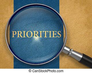 Priorities Concept through Magnifier. - Priorities Concept...