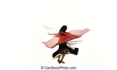 Beautiful exotic belly dancer with two wings and shaking her hips, on white