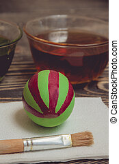 Painting eggs for easter holiday celebration