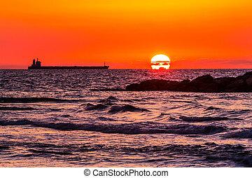 large ship on sunset background - maritime landscape, large...