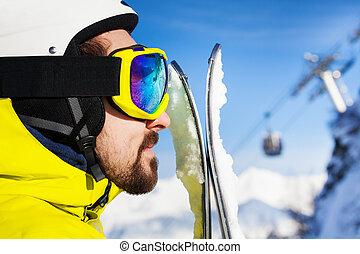 Profile close portrait of skier man - Close profile portrait...