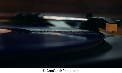 Vinyl start to play on a turntable - Detail shot of a vinyl...
