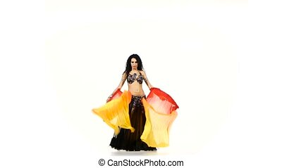 Beautiful exotic belly dancer woman with two long fans and shaking her hips, on white