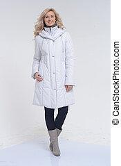 Young woman posing in white coat - Young beautiful woman...