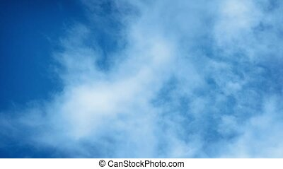 Clouds Moving Fast Across Blue Sky