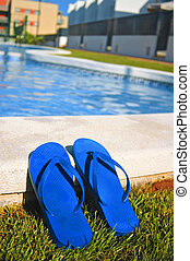 flip-flops - a pair of flip-flops on a swimming pool