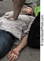 Dying car crash victim - Policeman doing chest compression...