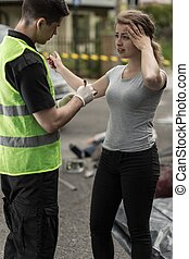Woman giving information - Young woman is telling policeman...