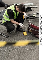 Crash site investigation - Policeman is numbering evidences...