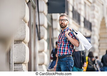 Hipster man shopping in the streets of London - Young...