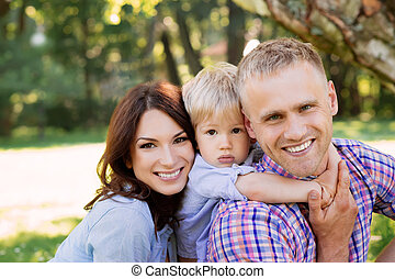 Close-up of happy family spending time together in the park