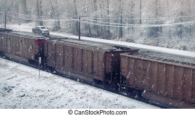 Car Passes Train Coming To Stop - Freight train comes to a...