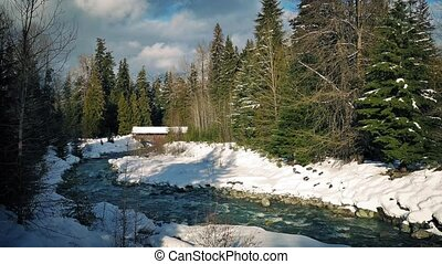 Covered Bridge In Snowy Landscape - Pretty scene of river...