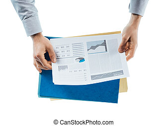 Business man checking a financial report - Businessman...