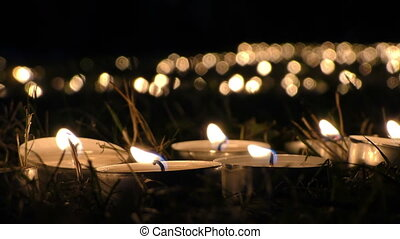 Candle on Grass at Night