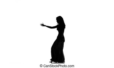 Exotic belly dancer woman dance on white, silhouette