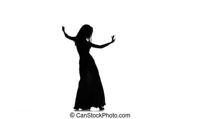 Exotic belly dancer woman starts dance on white, silhouette...
