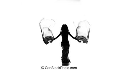 Exotic belly dancer woman dance with multicolored fans on white, silhouette