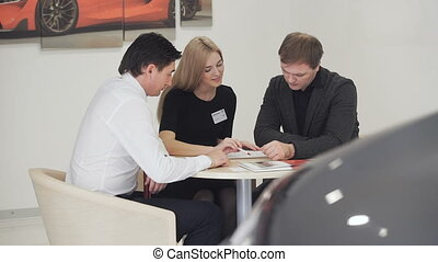 Business woman and businessman communicate with the client.