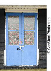 Blue beach hut doors