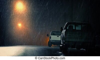 Parked Cars In City In Snowstorm - Couple of cars on the...