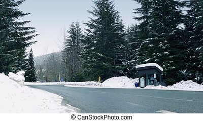 Minivan Passes Bus Shelter In Snow - Minivan drives past bus...