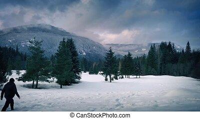 Man Walks In Deep Snow Landscape