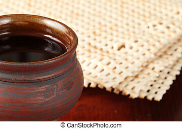 Red wine and matzo - Chalice with red wine and unleavened...