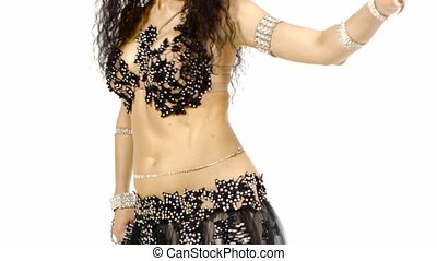 Torso of a female belly dancer, shaking her hips, on white