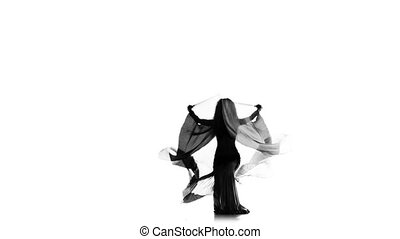 Slim talanted exotic belly dancer girl dance with wings on white, silhouette