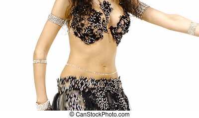 Torso of a exotic female belly dancer, shaking her hips, on white