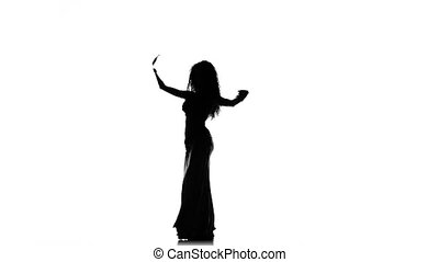 Talanted exotic belly dancer girl dance on white, silhouette...