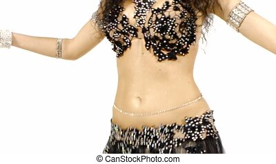 Torso of a beautiful female belly dancer, shaking her hips, on white